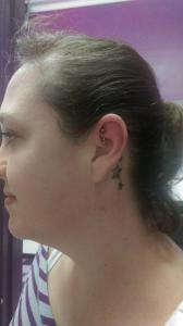 Rook piercing on Rae.